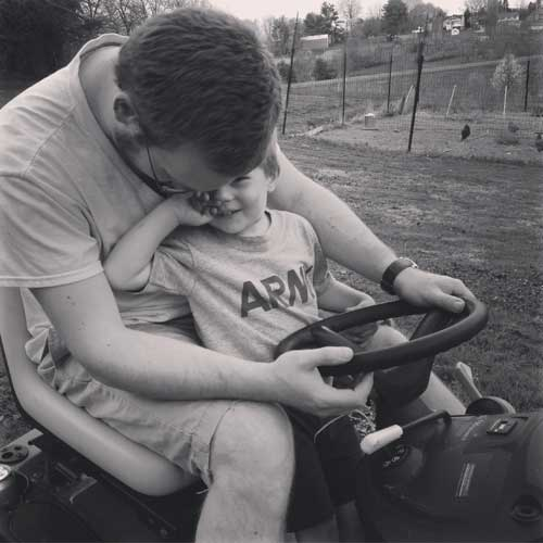 Grayson-and-his-Daddy-enjoying-the-Beautiful-Weather-and-the-Tractor